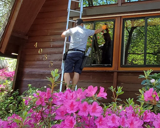 asf clean team service technician cleaning a residential window