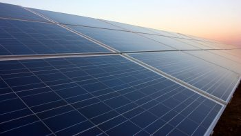 a set of clean solar panels boost energy in the sunset