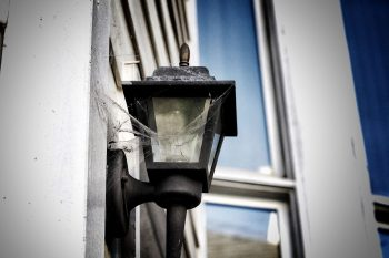 cobwebs on a porch lamp in San Francisco