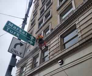 man washing high rise windows in San Francisco